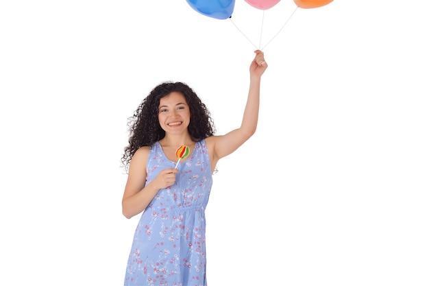 Bella donna con dolce lecca-lecca e baloons.