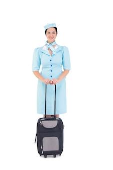 Bella hostess in possesso di valigia