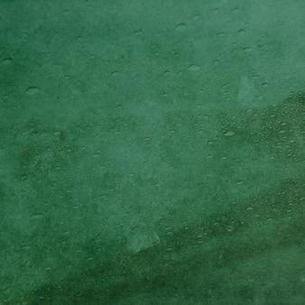 Bella trama verde con gocce di pioggia