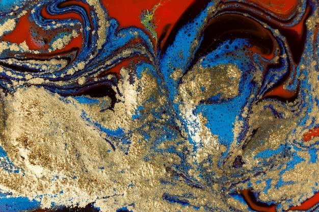 Bellissimi inchiostri misti dipingono con sfondo dorato in polvere.