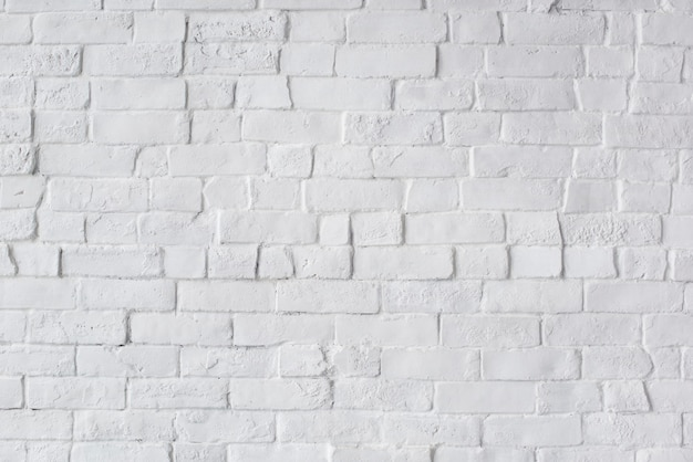 Bellissimo muro di mattoni dipinto di bianco