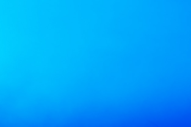 Bellissimo sfondo blu che si tinge dalla luce al buio. concetto cielo, aria e mare.