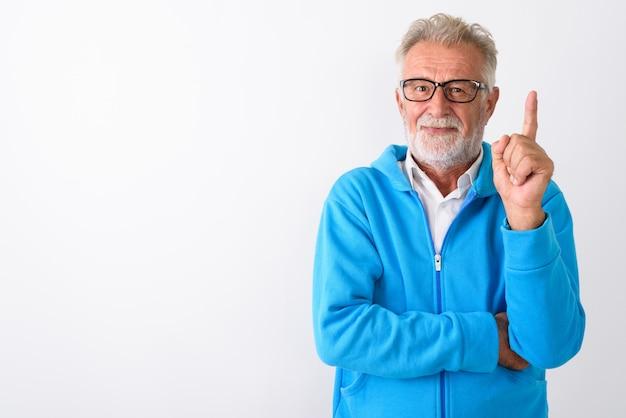 Bello, anziano, uomo barbuto, dito puntato, su, pronto, per, palestra, su, bianco