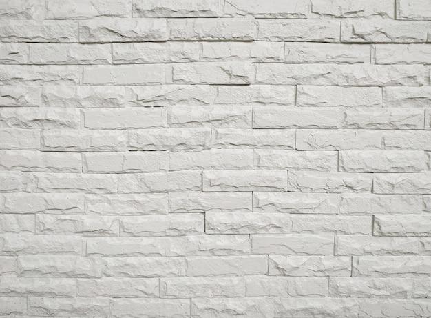 Bello del pavimento bianco del muro di mattoni