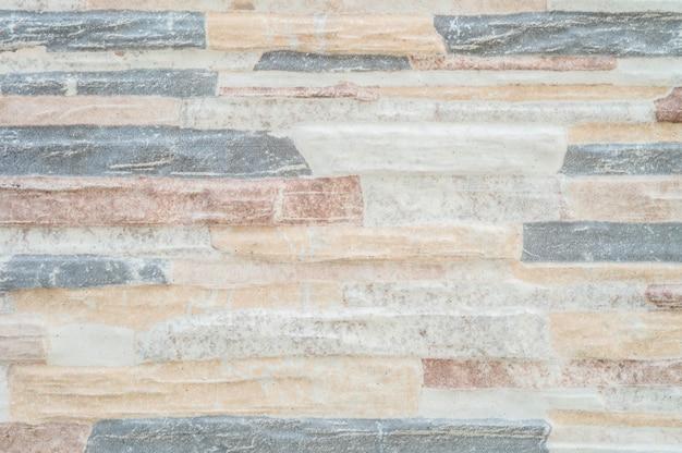 Bello fondo di struttura del muro di mattoni di pietra