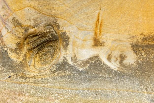 Bello sfondo di pietra di sabbia.