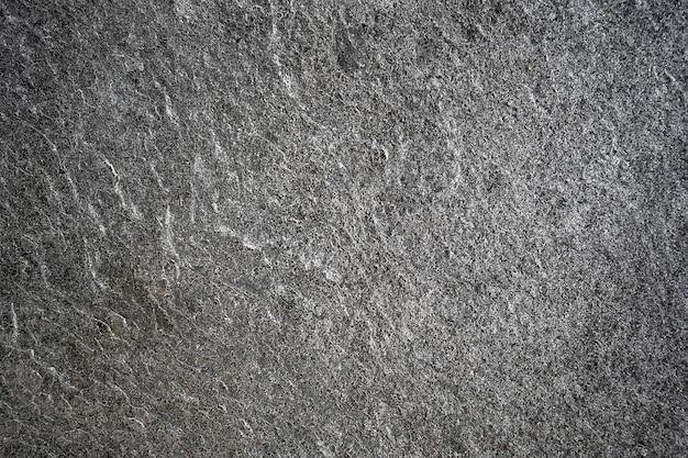 Bianco e nero di luce illuminata su pietra a strisce