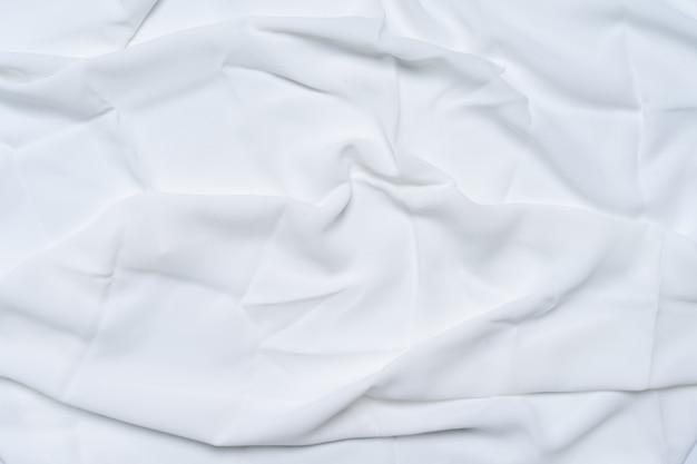 Bianco rugoso, increspato, superficie del tessuto texture di sfondo.