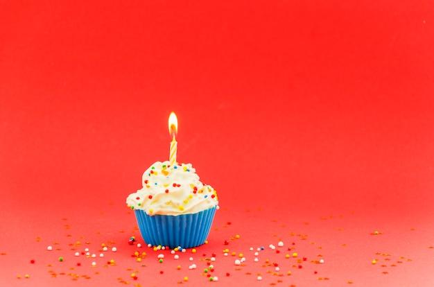 Bigné di compleanno con candela