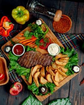 Bistecca ben fatta e patate fatte in casa