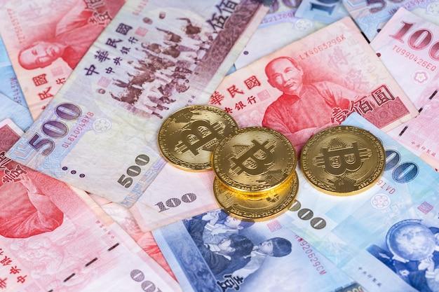 Bit moneta con nuova banconota da un dollaro di taiwan