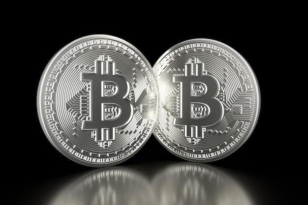Bitcoin. le monete d'argento con il simbolo del bitcoin isolato su 3d nero rendono.
