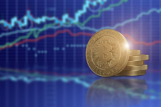 Bitcoin moneta d'oro su uno sfondo di grafici aziendali