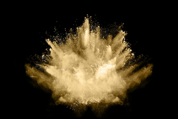 Blocca il movimento della polvere dorata che esplode, isolato su sfondo nero