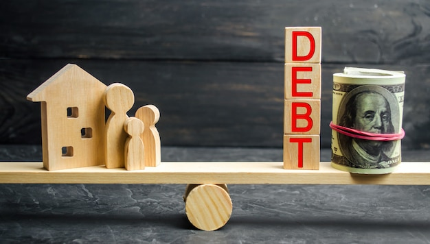 Blocchi con la parola debito e denaro
