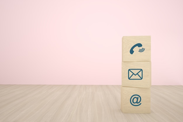 Blocco di cubo di legno tre che impila con l'icona di contatto che sistema in una fila su fondo di legno. concetto di strategia aziendale e piano d'azione.
