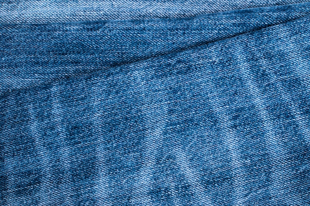 Blue jeans e trama di punti. sfondo denim con cucitura