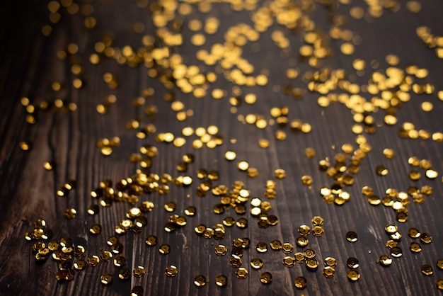 Bokeh astratto dell'oro con fondo nero