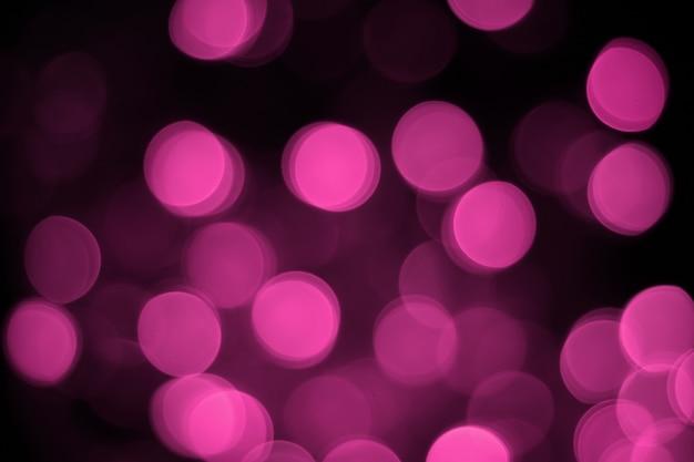 Bokeh astratto su sfondo rosa