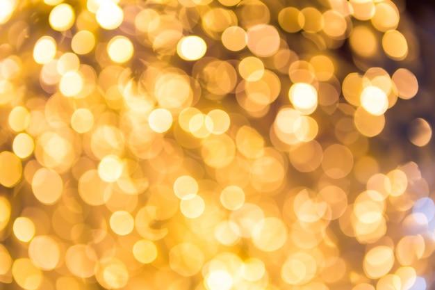 Bokeh defocused oro sfondo natale