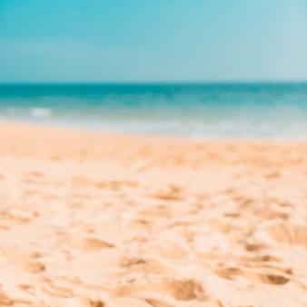 Bokeh della spiaggia di estate per fondo