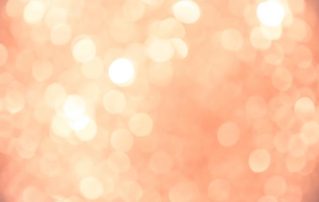 Bokeh dorato dorato del fondo di rosa del fondo