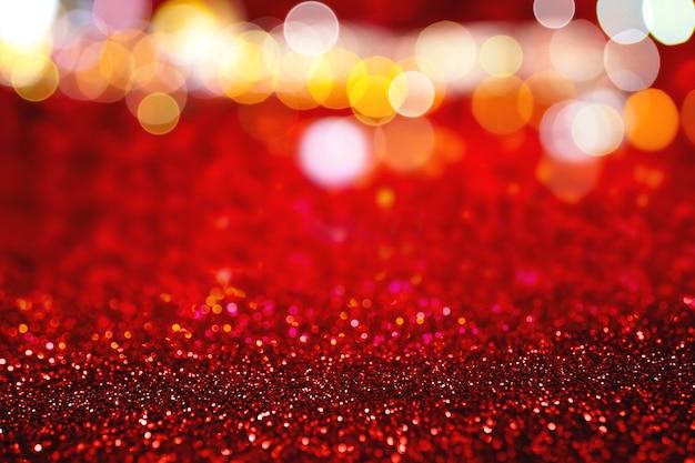 Bokeh rosso e luccica sfondo di natale e capodanno