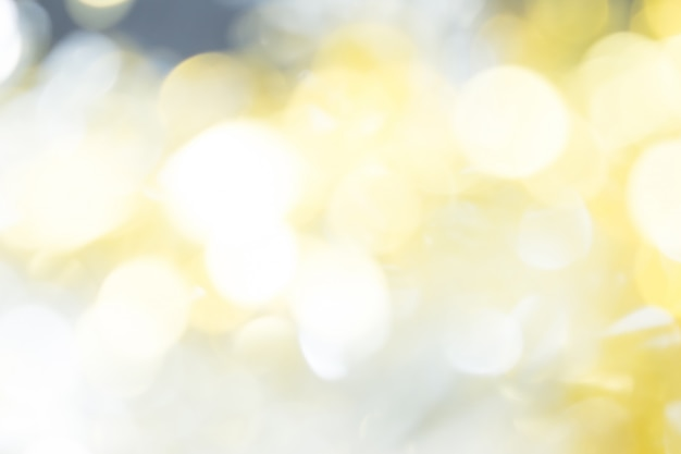 Bokeh sfondo grigio e dorato bellissimo.