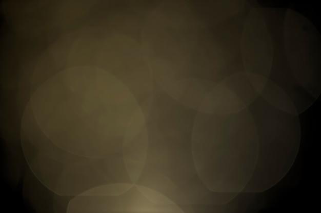 Bokeh tono puntino arancione e nero per lo sfondo