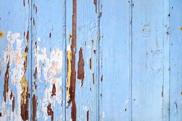 Bordo di legno anziano dipinto fondo blu