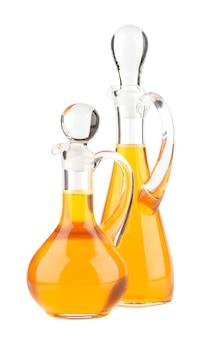 Bottiglia di vetro dell'olio vegetale isolata su bianco