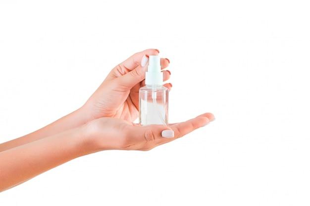 Bottiglia femminile della crema della tenuta della mano di lozione isolata