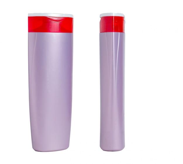 Bottiglia isolata di plastica viola in bianco. imballaggio per shampoo, cosmetici. vista frontale e laterale