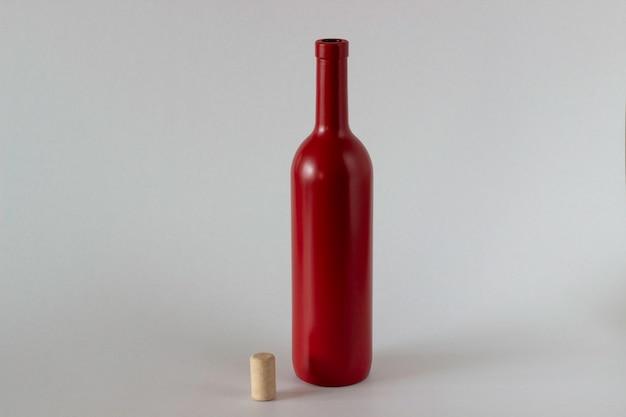 Bottiglia rossa e tappo