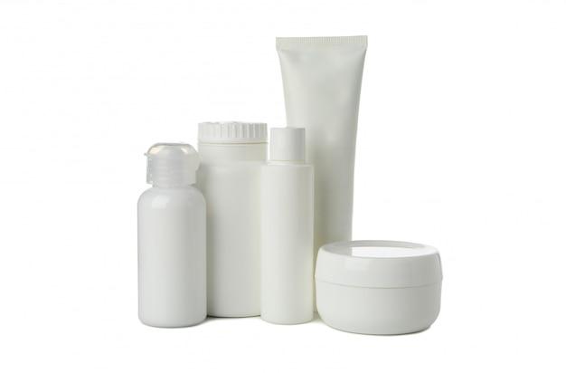 Bottiglie vuote per cosmetici isolati su sfondo bianco
