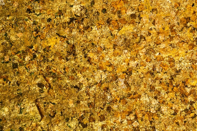 Brillante foglia oro giallo o ritagli di texture di sfondo lamina d'oro