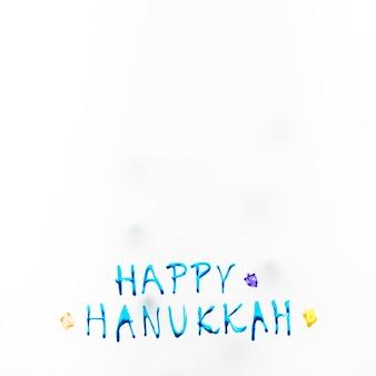 Brillante scrittura di hanukkah felice