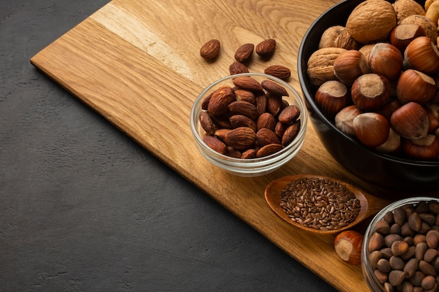 Brown huzelnuts on a wooden cutboard