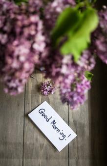 Buongiorno nota con fiori lilla