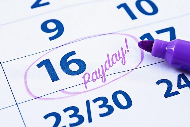 Calendario con cerchio indicatore in parola payday