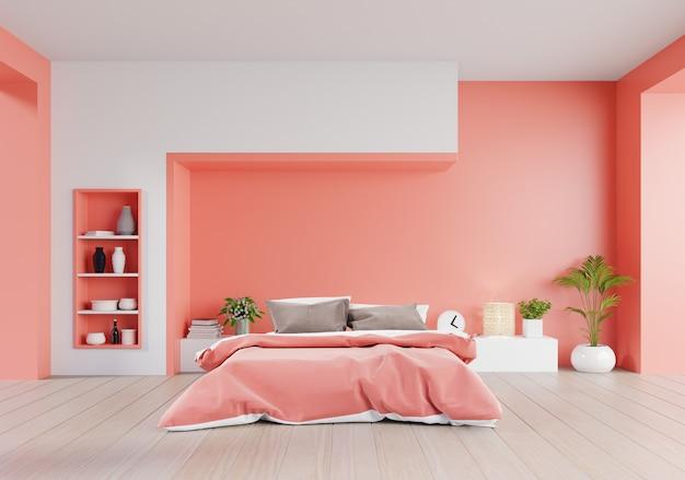 Camera da letto color corallo vivente della casa di lusso con letto matrimoniale e scaffali