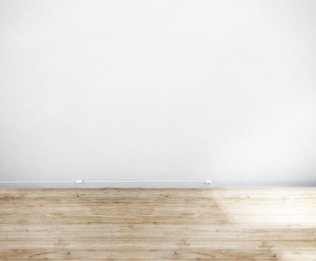 Camera realizzata con pareti bianche e pavimento in legno