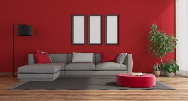 Camera rossa moderna con divano grigio