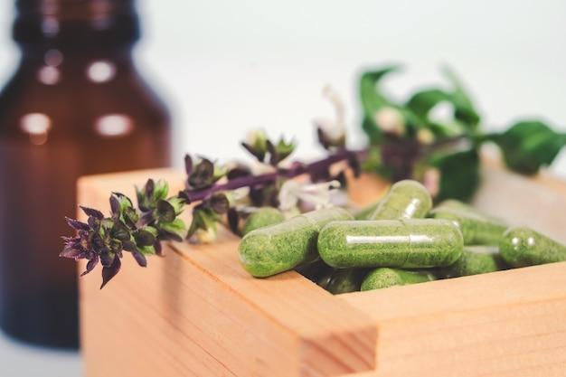 Capsula di erbe alternativa in scatola di legno
