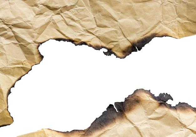 Carta bruciata annata di brown, dettagli isolati, grande fondo, struttura