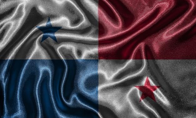 Carta da parati con bandiera panamense e bandiera sventolante in tessuto.