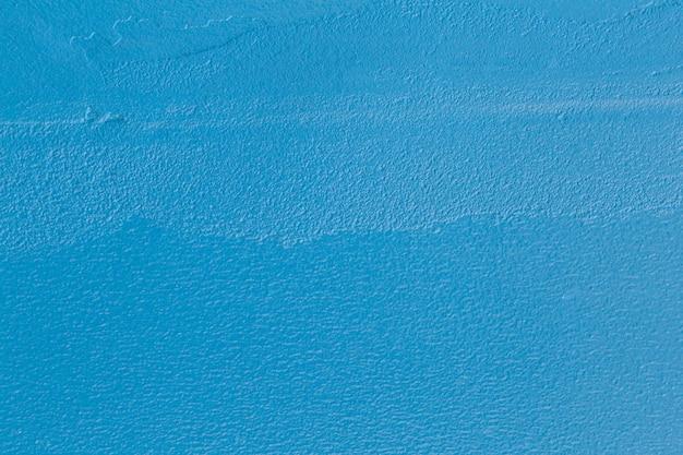 Carta da parati concreta del fondo di colore blu.