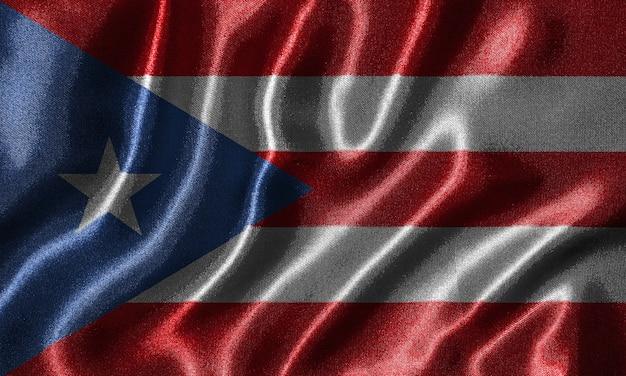 Carta da parati della bandiera di porto rico e bandiera sventolante in tessuto.