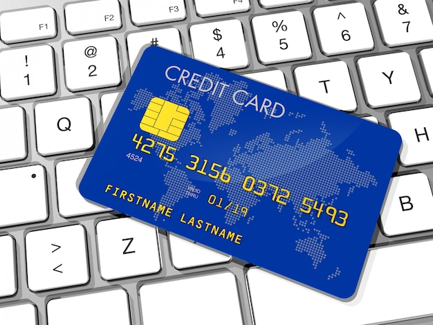 Carta di credito blu sulla tastiera di un computer