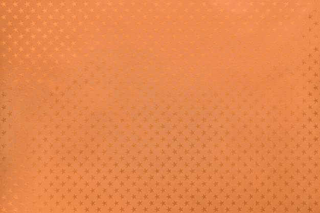 Carta metallizzata arancione con motivo a stelle